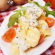 Tortellini pasta with cheese sauce and tomato — Stock Photo