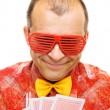 Gambler holding playing cards and smiling — Stock Photo