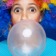 Young girl blowing bubble gum ballon - Stock Photo