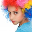 Beautiful young girl with party wig — Stock Photo