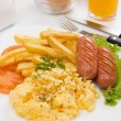 Scrambled eggs with sausage and french fries — Stock Photo