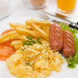 Scrambled eggs with sausage and french fries — Stock Photo #5664215