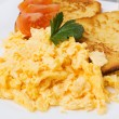 Scrambled eggs with toasted bread — Stock Photo