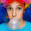 Young girl blowing bubble gum balloon — Stock Photo