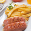Grilled sausage with french fries — Stock Photo #5664745