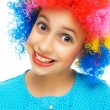 Young girl with colorful party wig — Stock Photo