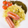 Sauerkraut with sausages, traditional german meal — Stock Photo