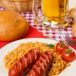 Grilled sausage with white beans — Lizenzfreies Foto