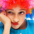 Young girl with party wig — Stockfoto