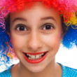 Smiling girl with party wig — Stockfoto