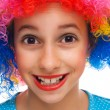 Smiling girl with party wig — Stock Photo