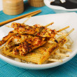 Asian chicken skewer with baby corn and rice — Stock Photo