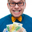 Smiling man holding handful of money — Stock Photo #5666164