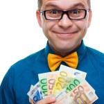Happy man with handful of money — Stock Photo