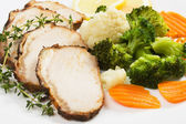 Pork roast slices with vegetables — Stock Photo
