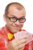 Smiling gambler holding playing cards — Stock Photo