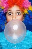 Young girl blowing bubble gum ballon — Stock Photo