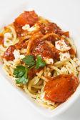 Spaghetti pasta with cheese and tomato sauce — Stock Photo