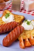Grilled sausage with french toast — Stock Photo