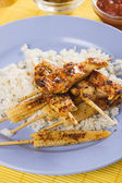 Asian skewed chicken with rice and baby corn — Stock Photo