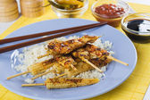 Grilled skewed chicken with baby corn and rice — Stock Photo