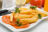 French fries served with fresh tomato — Stock Photo