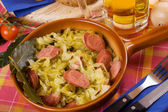Sauerkraut with sausage — Stock Photo