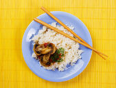 Cooked rice with mushrooms — Stock Photo
