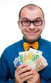 Happy man with handful of money — Stock Photo