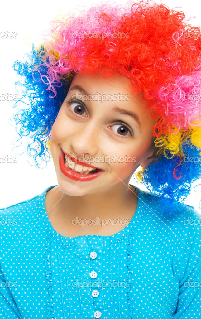 Young girl with colorful party wig on white background — Stock Photo #5665211