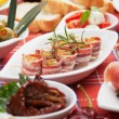 Stock Photo: Bacon rolls and other antipasto food