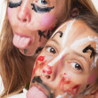 Young girls with painted face — Stock Photo