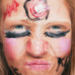 Young girl with painted face — Stock Photo #6675507
