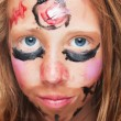 Young girl with painted face — Stock Photo