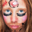 Young girl with painted face — Stock Photo #6676690