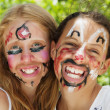 Young girls with painted faces — Stock Photo #6678409