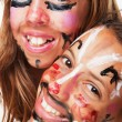Two painted faces — Stock Photo