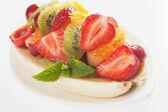 Banana split with fresh fruit — Stock Photo