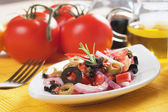 Fresh salad with tomato and olives — Stock Photo