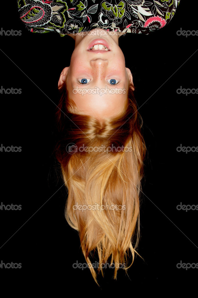 Beautiful girl with long red hair hanging upside down — Stock Photo #6678952