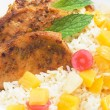 Spicy pork loin chops with tropical fruit and rice — Stock Photo