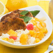 Pork loin chops with tropical fruit and cooked rice - Stock Photo