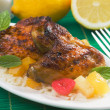 Caribbean style grilled chicken wings - Stock Photo