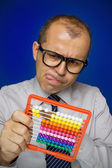 Man with abacus calculator — Stock Photo