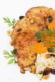 Spicy pork loin chops with nuts, rice and vegetables — Stock Photo