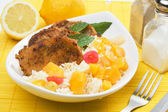 Pork loin chops with tropical fruit and cooked rice — Stock Photo
