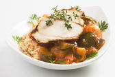 Roasted pork loin with rice ande vegetables — Stock Photo
