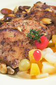 Caribbean style pork chops with tropical fruit — Stock Photo