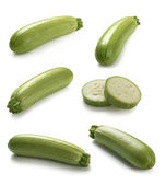 Some vegetable marrows on the white background — Stock Photo