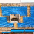 Empty rows of seats at football stadium - Stock Photo